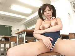 Busty Japanese teasing in the cl...
