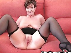 Classy granny in stockings shows...
