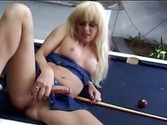 Shemale romps on a billiard table