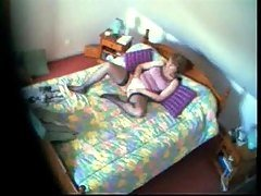 Mom fingering in bed watching a ...