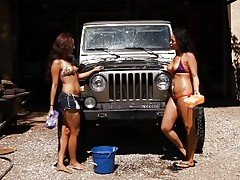 Two tanned car washers break for...