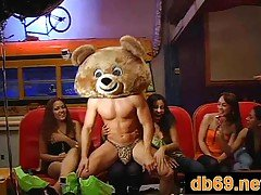 Drunk girls at party with bear s...