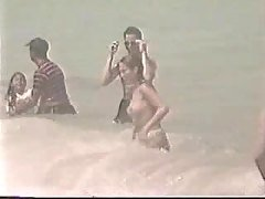 Topless teen girl - beach video