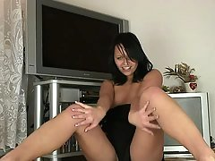 Black haired nymph peels off her...