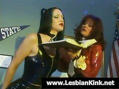 Lesbians in latex spanking their...