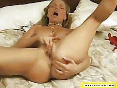 Sexy tanned MILF gets naughty in...